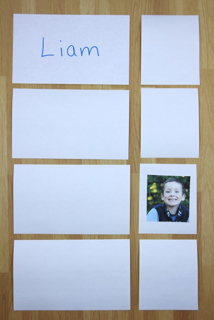 Photo of memory game using names. Four cards contain student names and 4 smaller cards contain student photos. One of each is turned over to match.