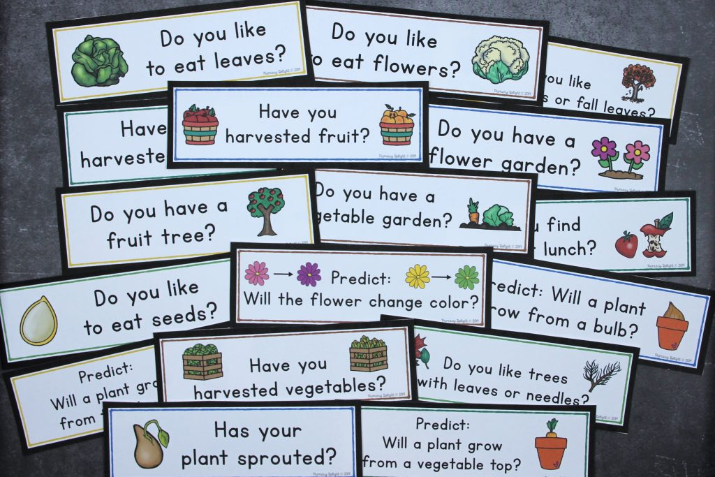 Several questions spread out on a table. Questions include: Do you like to eat leaves? Have you harvested fruit? Do you have a vegetable garden? Predict: Will a plant grow from a vegetable top