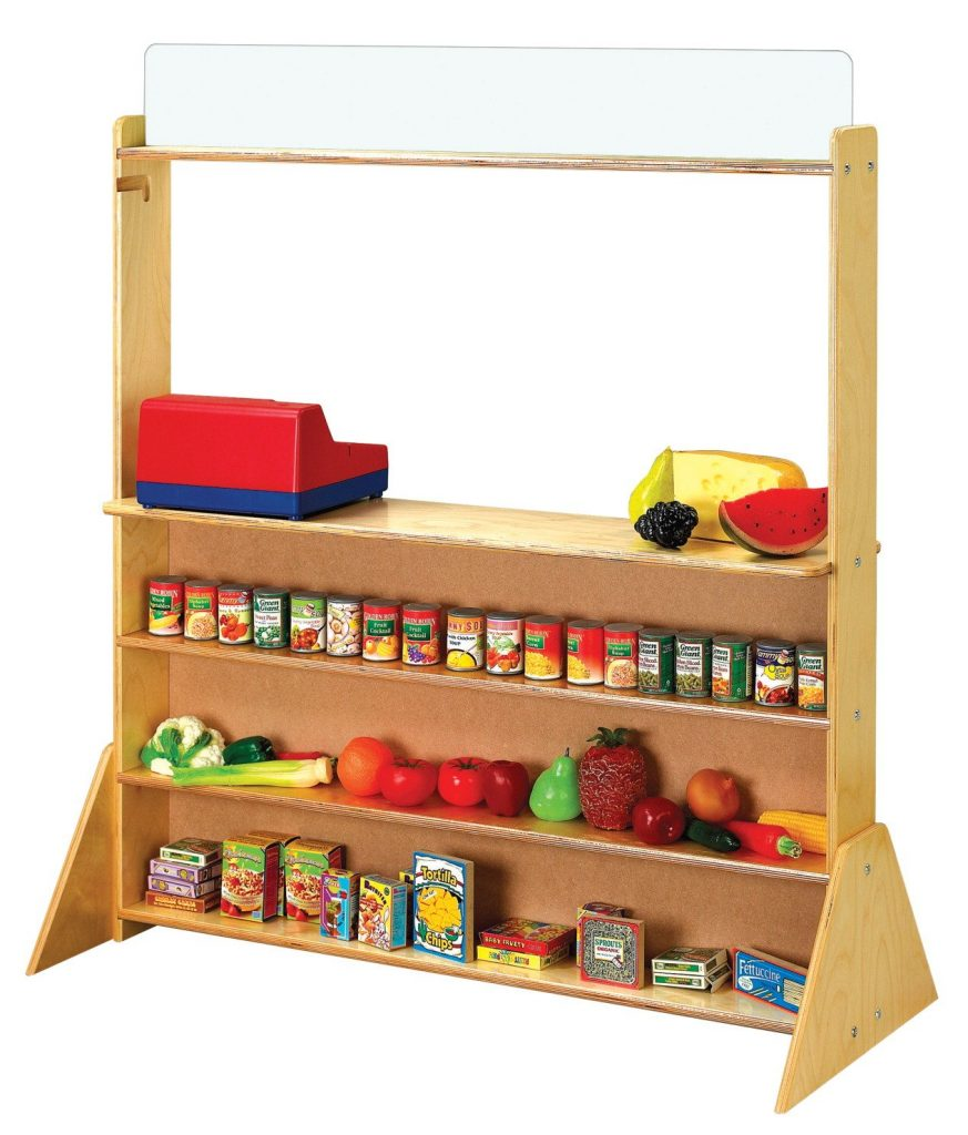 Photo of a puppet theater being used to organize the dramatic play center kitchen. The pretend food is stored on the shelves.