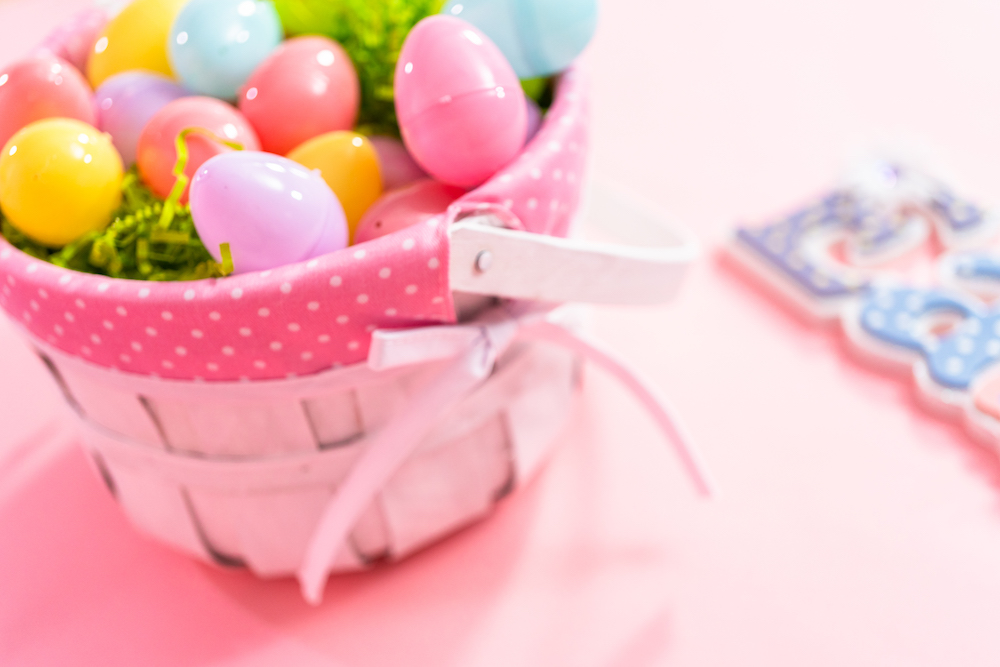 Photo of an Easter basket filled with plastic eggs.