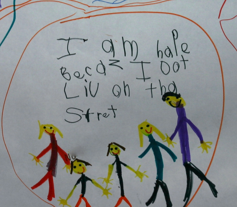 """Photo of a student writing samples that says """"I am HAPE BECAZ I LIV ON THA STRET"""" (I am happy because I live on that street.)"""