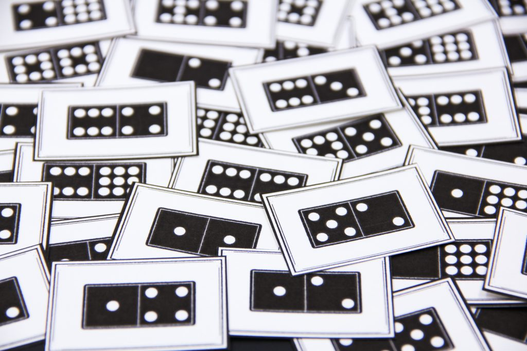 Photo of printable domino cards to help kids practice math skills with a game.