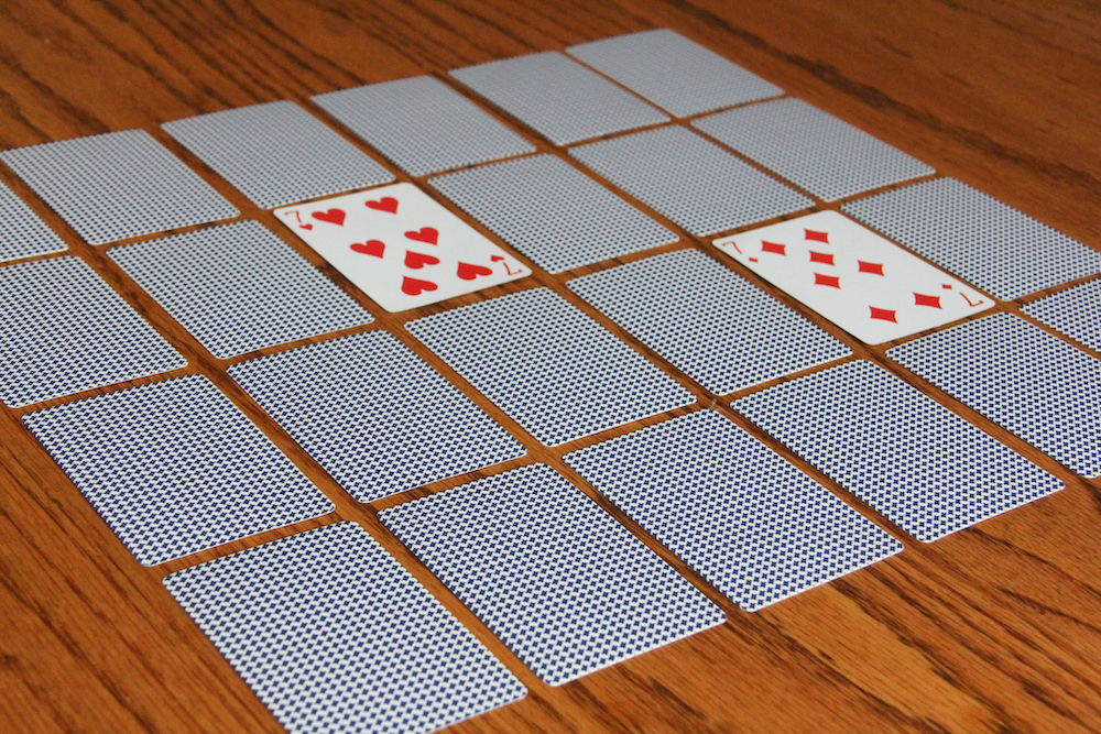 Photo of playing cards arranged for playing memory games - a great way for kids to practice math skills.