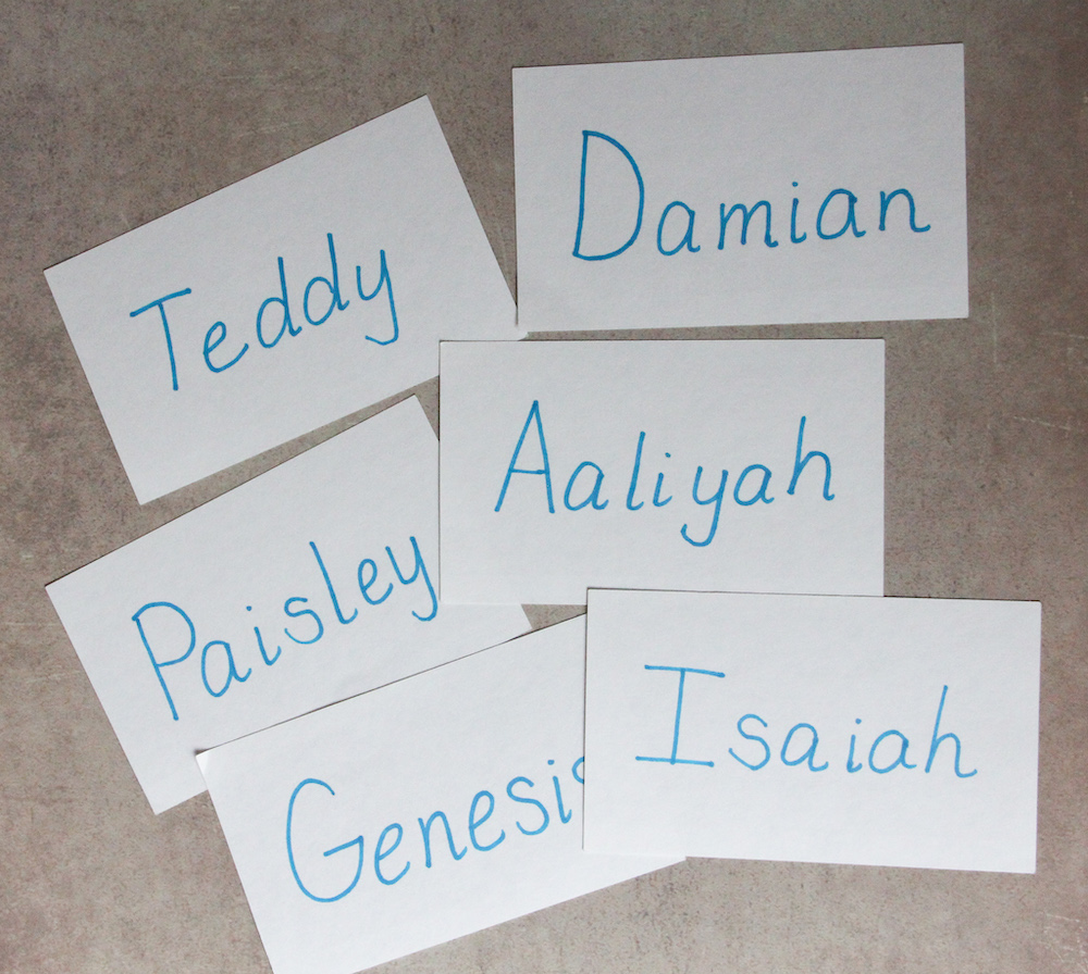 Photo of 6 student name cards spread out on a table.