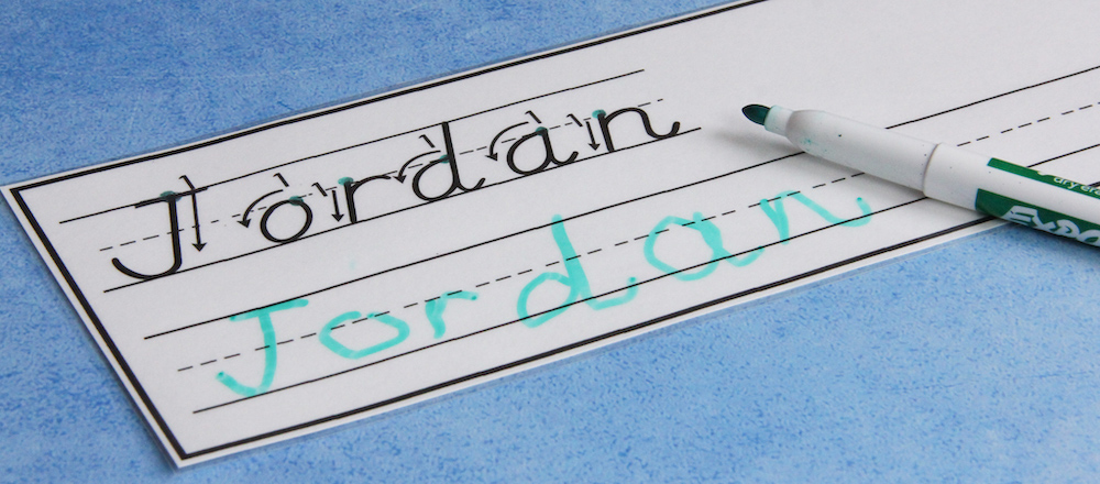 "Photo of a card that shows how to form the letters in the name ""Jordan."" The student wrote the name on the line below."