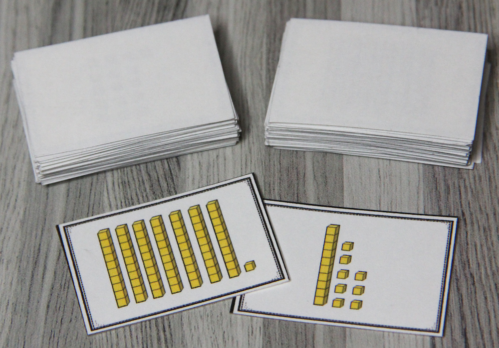 Photo of a card game that shows longs and cubes (place value blocks.)