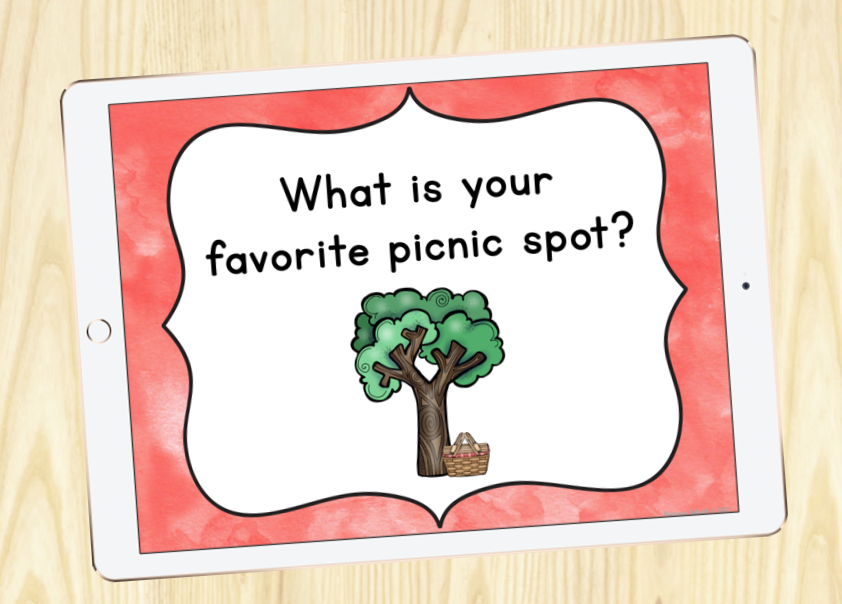 """Photo of an iPad that displays an image with the question """"What is your favorite picnic spot?"""")"""