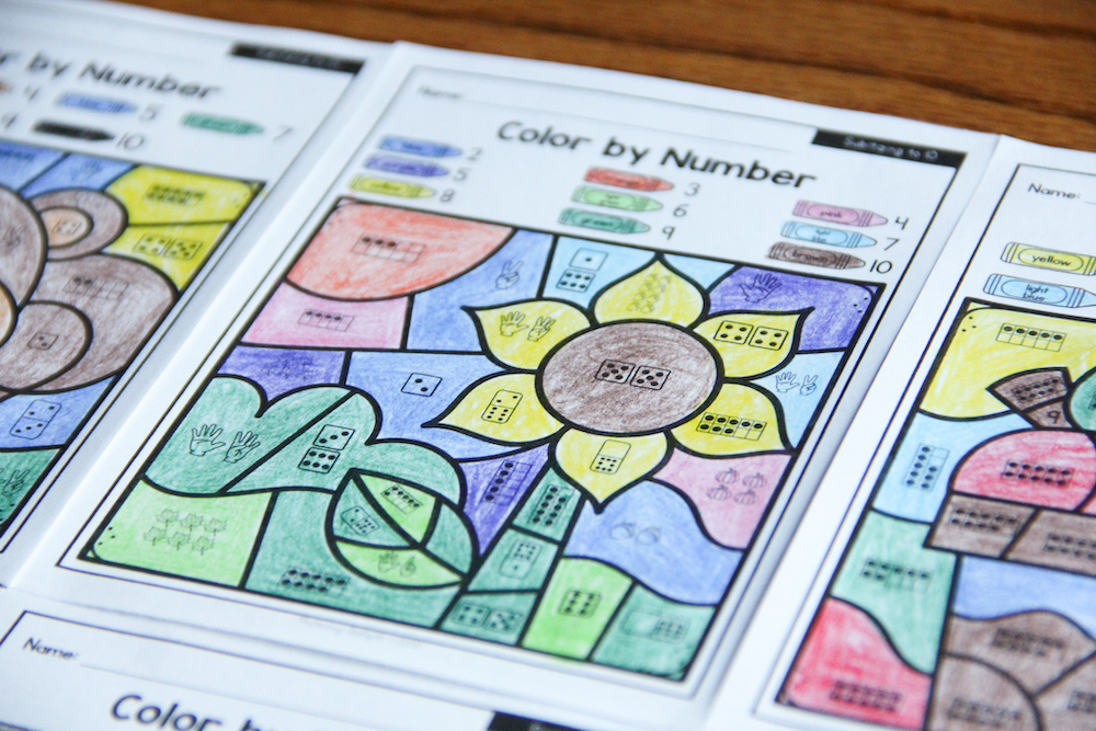 Photo of color by number pages for numbers 1-10. Image on page is a sunflower surrounded by colorful spaces.