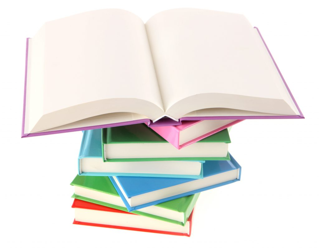 Photo of a colorful stack of books, with the top book wide open.