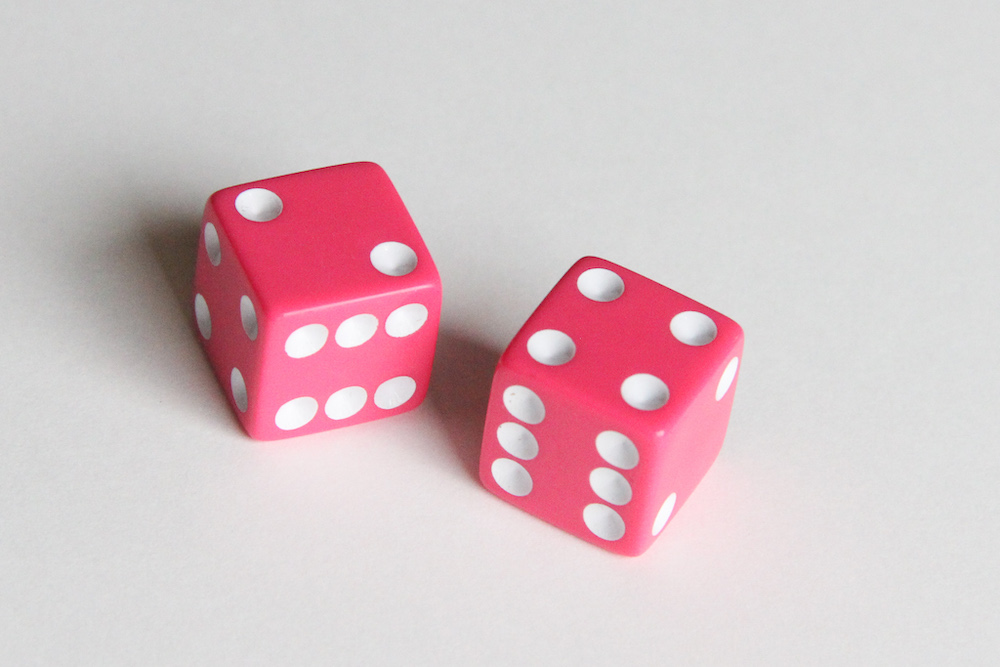 Photo of two pink dice.