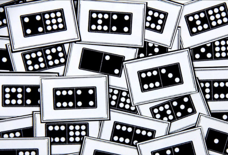 Photo of dominoes printed on cards.