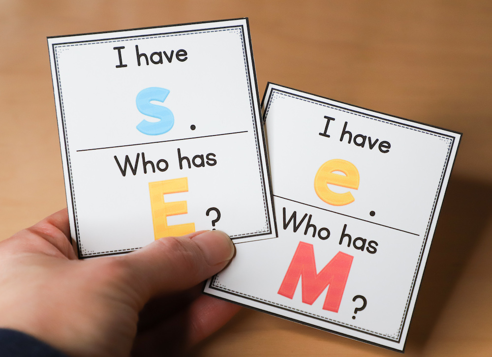 I Have... Who Has... with letter names is one of many fun alphabet activities for kindergarten, as is shown in this photo with two game cards.