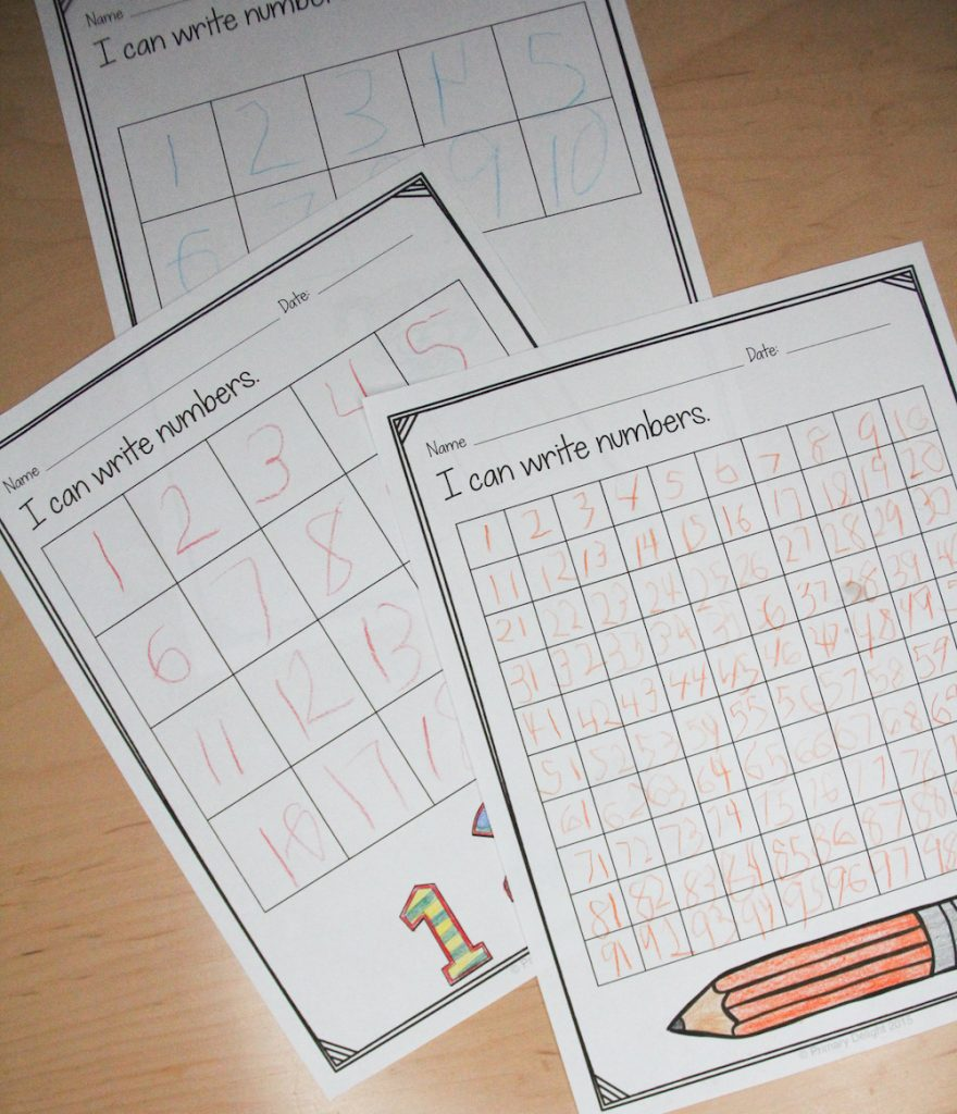 Photo of 3 different samples of number writing from different times in the school year. These pages can easily show growth at parent conferences.