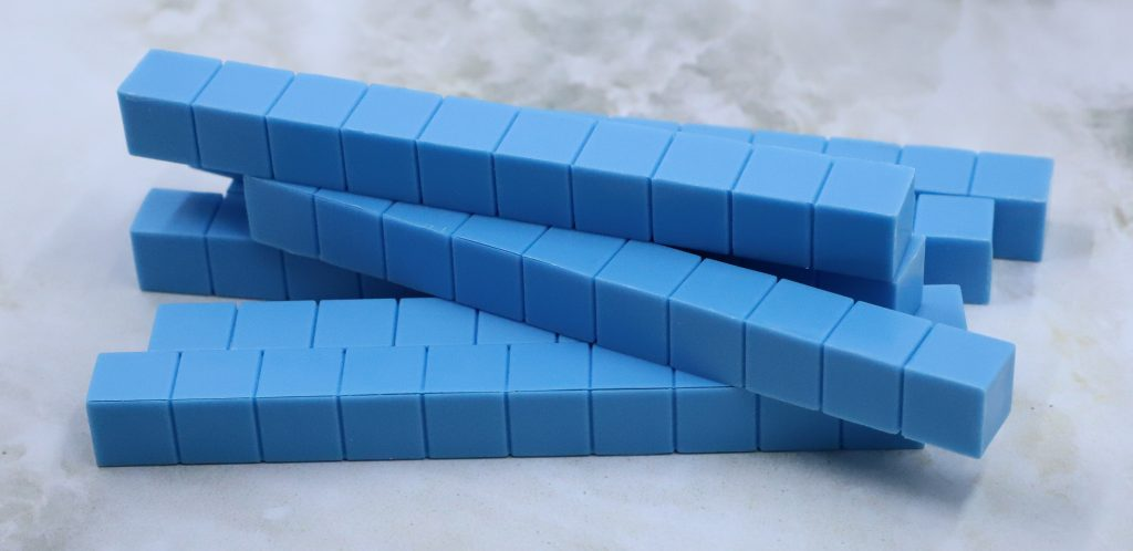 Photo shows a stack of blue ten blocks.