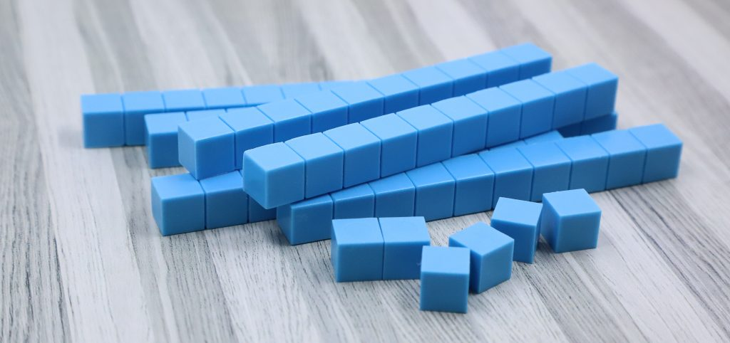 Photo shows a stack of tens blocks with 6 ones blocks.