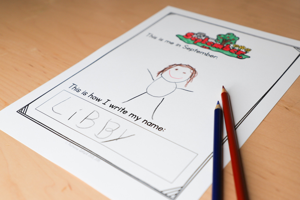 Photo shows a self-portrait stick figure from a child on the first day of school after distance learning. The page also includes space for the child to write her name.